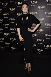 Gong Li polished off her all-black look with an elegant Fendi tote.