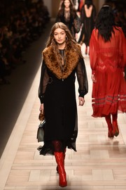 Gigi Hadid made a luxurious statement with this fur-lapel coat on the Fendi runway.