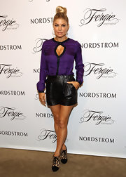 Fergie rocked a pair of high-waisted black leather shorts for the launch of her footwear collection at Nordstrom.