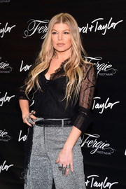 Fergie accessorized with loads of statement rings for a personal appearance at Lord & Taylor.