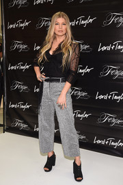 Fergie made a personal appearance at Lord & Taylor wearing a sultry black lace blouse.