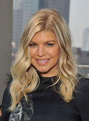 Fergie wore her long ultra-blond locks in loose waves during a press day in NYC.