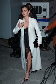 Penelope Cruz arrived for the Feroz Awards wearing a long white wool coat over a lacy black dress.