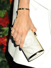Eva chose a white clutch to match her lovely white frock while at the NYC launch of L'Icona Highlighting.