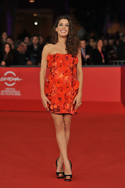 Giulia showed off her stems in this iridescent red appliqued number at the Rome film festival.
