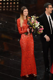 Bianca Balti partnered a pair of embellished red evening pumps with her transparent red gown at the closing night of the Festival di Sanremo 2013.