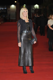 Olivia Newton-John stepped out at the red carpet premiere of 'A Few Best Man' wearing a leather dress topped with a sheer beaded bolero.
