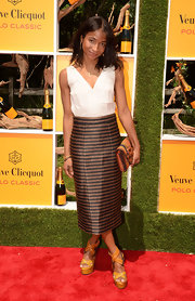 Genevieve Jones wore funky orange woven wedge heels to the fifth annual Veuve Clicquot Polo Classic.