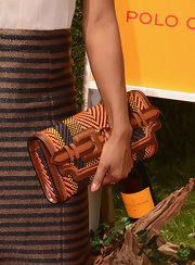Genevieve Jones carried an amazing tribal print inspired multicolored clutch to the 5th annual Veuve Clicquot Polo Classic.