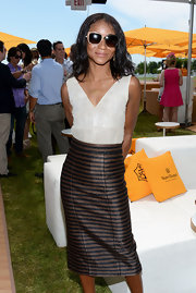 Genevieve Jones attended the VIP Marquee in a shimmering black and brown striped pencil skirt.