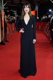 Dakota Johnson was all about understated elegance in a deep-V black button-down gown by Christian Dior at the 'Fifty Shades of Grey' premiere in Berlin.