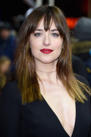 Dakota Johnson went to the 'Fifty Shades of Grey' premiere in Berlin wearing a simple straight hairstyle with wispy bangs.