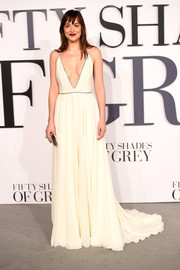 Dakota Johnson took a very daring plunge in a white Saint Laurent gown with a down-to-the-navel neckline during the London premiere of 'Fifty Shades of Grey.'