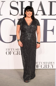 E. L. James went for classic glamour in a beaded gray dress with knotted detailing during the 'Fifty Shades of Grey' London premiere.