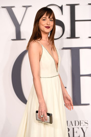 Dakota Johnson paired a Roger Vivier Boite de Nuit clutch with a sexy Grecian gown for the 'Fifty Shades of Grey' London premiere.