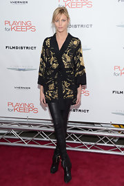 Anja Rubik sported a stylish mix of classic and modern with a kimono-inspired print top and a pair of leather skinnies.