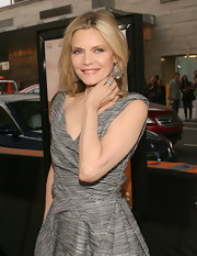 Michelle Pfeiffer amped up the glam factor with a pair of dangling diamond-studded hoops at the 'People Like Us' premiere.
