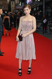 Kate Mara styled her cute frock with a pair of purple velvet platforms.
