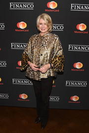 Martha Stewart attended the Financo CEO Forum 2017 wearing a printed swing jacket with fur cuffs.