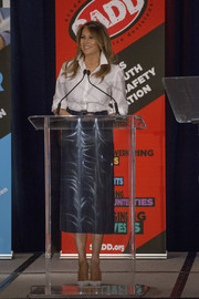 Melania Trump paired a navy Calvin Klein pencil skirt with a white button-down for the S.A.D.D. Conference.