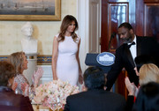 Melania Trump wore a form-fitting white dress at a luncheon for governors' spouses.