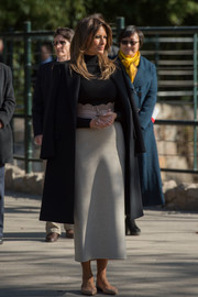 Melania Trump donned a black Dolce & Gabbana wool coat for added warmth.