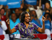 MObama's buoyant curls were full of bounce at a campaign rally in Miami.