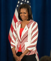 Michelle Obama welcomed the members of the 2012 USA Olympic team wearing a red and white print blazer.