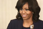 Michelle Obama spruced up her black outfit with a pretty flower brooch when she hosted the cast and crew of '42.'