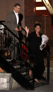 Michelle Obama added some sexiness to her ensemble with a pair of black strappy sandals.