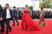Eleonora Carisi channeled her inner princess in a strapless red ballgown with an embellished waistband at the Venice Film Festival premiere of 'First Man.'
