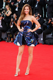 Barbara Palvin paired her cute frock with metallic sandals.