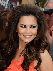 Cheryl Cole flashed her fluttery lashes at the camera's. Bold lashes are always a great way to spice up a red carpet look.