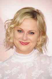 Amy Poehler wore her hair in a casually tousled updo featuring long loose curls for the premiere of 'The Five Year Engagement.'