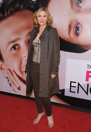 Kim Cattrall tossed on this metallic trench over her corset ensemble at the premiere of 'The Five Year Engagement.'