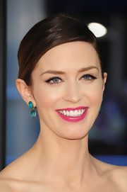 Emily Blunt's super sleek look was topped off with this side-parted bun.