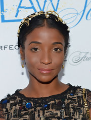 Genevieve Jones looked stunning in a gold floral headband with pearl accents at the Flawsome Ball.