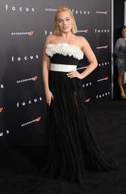 Margot Robbie was all abloom at the 'Focus' premiere in a black-and-white Giambattista Valli Couture strapless gown featuring a thick layer of flower appliques along the bustline.