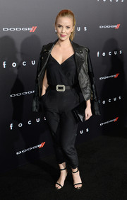 Kelli Garner draped a black leather jacket over her shoulders for an edgy finish to her jumpsuit.