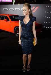 Carmen Electra flaunted her curves and cleavage in a tight-fitting, low-cut print dress during the premiere of 'Focus.'