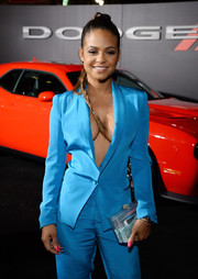 Christina Milian teamed a perspex box clutch with a sexy pantsuit for the premiere of 'Focus.'