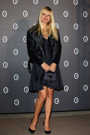 Michelle Hunziker chose a black shiny motorcycle jacket with a matching belt to pair with her navy dress.