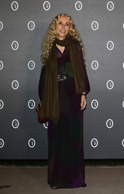 Franca Sozzani opted for a deep purple maxi dress with rich green tapestry prints for her look at the Fondazione Nicola Trussardi Cocktail Party in Venice.