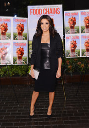 Eva Longoria donned a simple black skirt suit, punched up with a fitted leather top, for the 'Food Chains' New York screening.