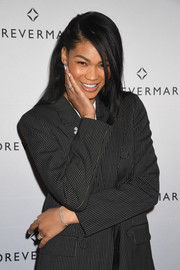 Chanel Iman accessorized with a delicate diamond bracelet at the Females in Focus photo exhibition.