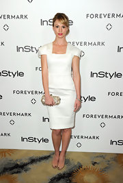 Cameron Richardson paired her white frock with nude peep-toe pumps.