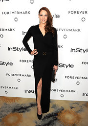 Amanda Righetti brought on the glam in a black faux-wrap evening dress.