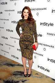 Alexandra Breckenridge added the perfect pop to her bold print dress with a fire engine red clutch.