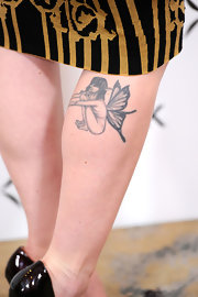Alexandra Breckenridge showed off her upper calf tattoo at the 'InStyle' Golden Globe Awards Event.