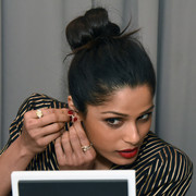 Freida Pinto gathered her hair into a knot for the Forevermark Tribute event.
